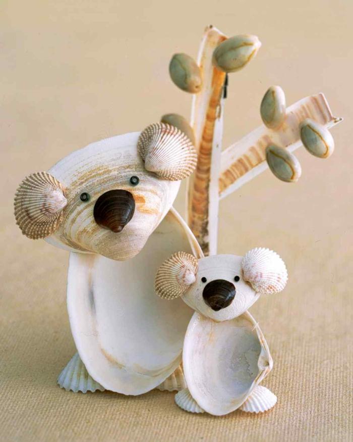 manualidades paso a paso, osos panda hechos de conchas del mar