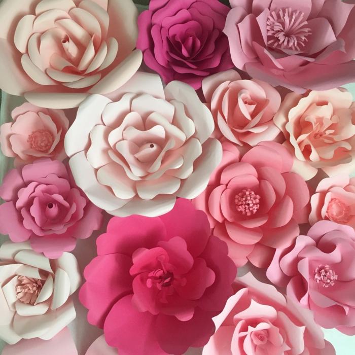 papel pinocho, flores de papel en diferentes tonos de rosado