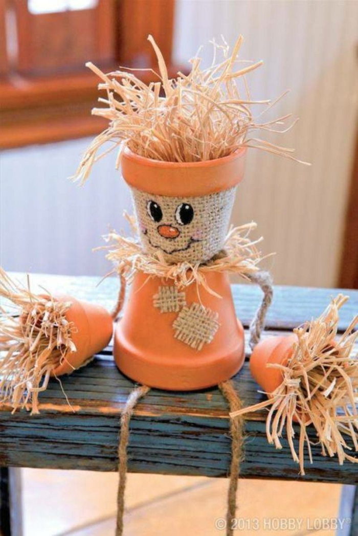 manualidades faciles de hacer, muñeca hecha de macetas y paja con cara