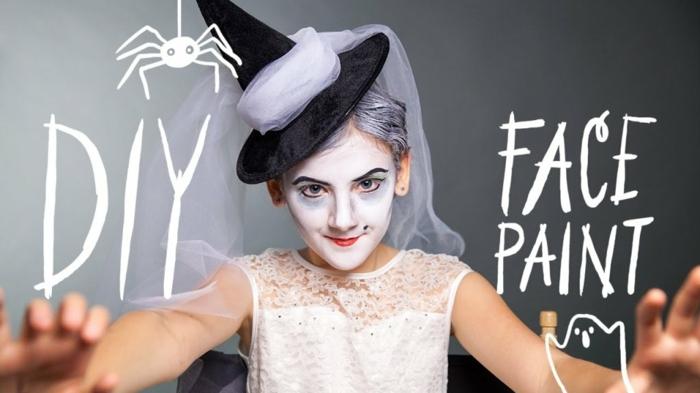 maquillaje halloween niños, bruja pequeña con cara y pelo blanqueados, verruga disimulada, y cejas marcadas en negro