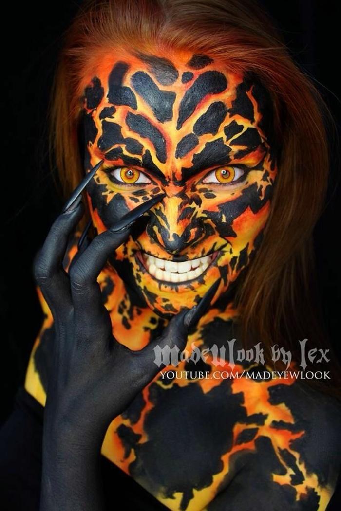 bruja halloween, bruja asquerosa de fuego, piel pintada en negro y color naranja, largas uñas afiladas negras