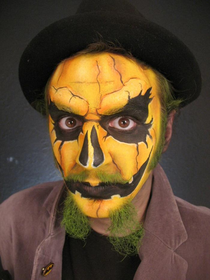 maquillaje zombie, maquillaje para hombre como calabaza amarilla, barba pintada en verde y gorro