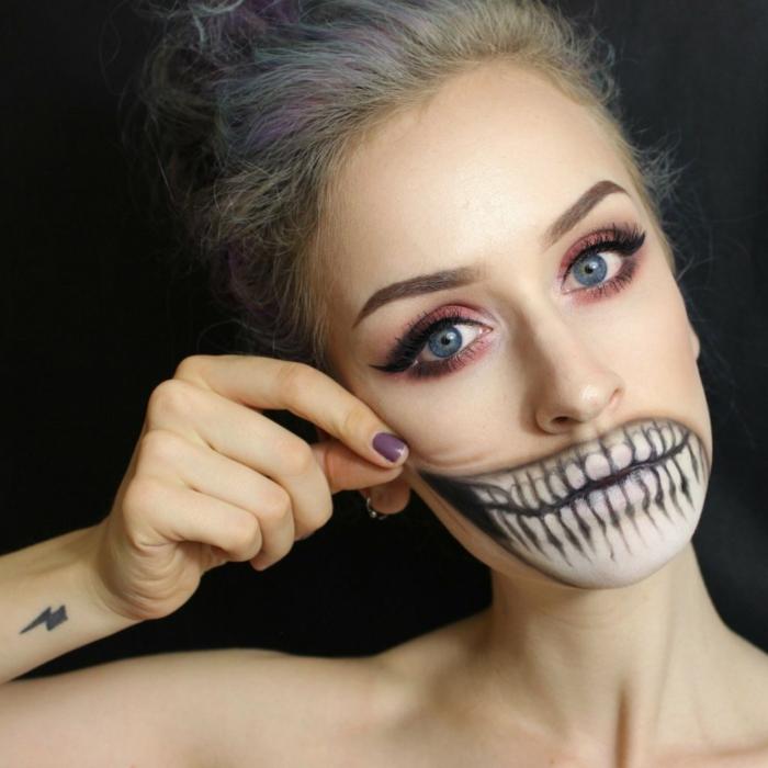 maquillaje vampiresa, mujer con boca de calavera y grandes dientes, esmalte púrpura