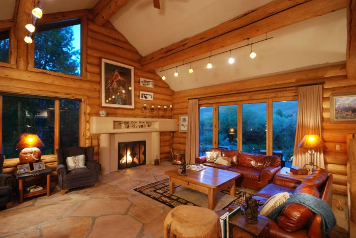 ideas decoracion, salon rustico con chimenea y suelo de piedra, muebles tapizados piel, mesa de madera