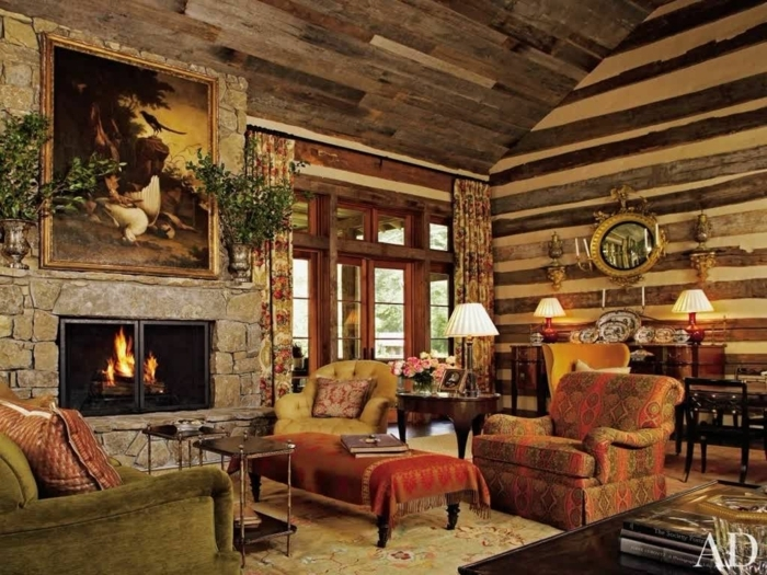 salones rusticos, salon con chimenea de piedra, rojo y amarrillo, cuadro, plantas verdes, paredes de madera
