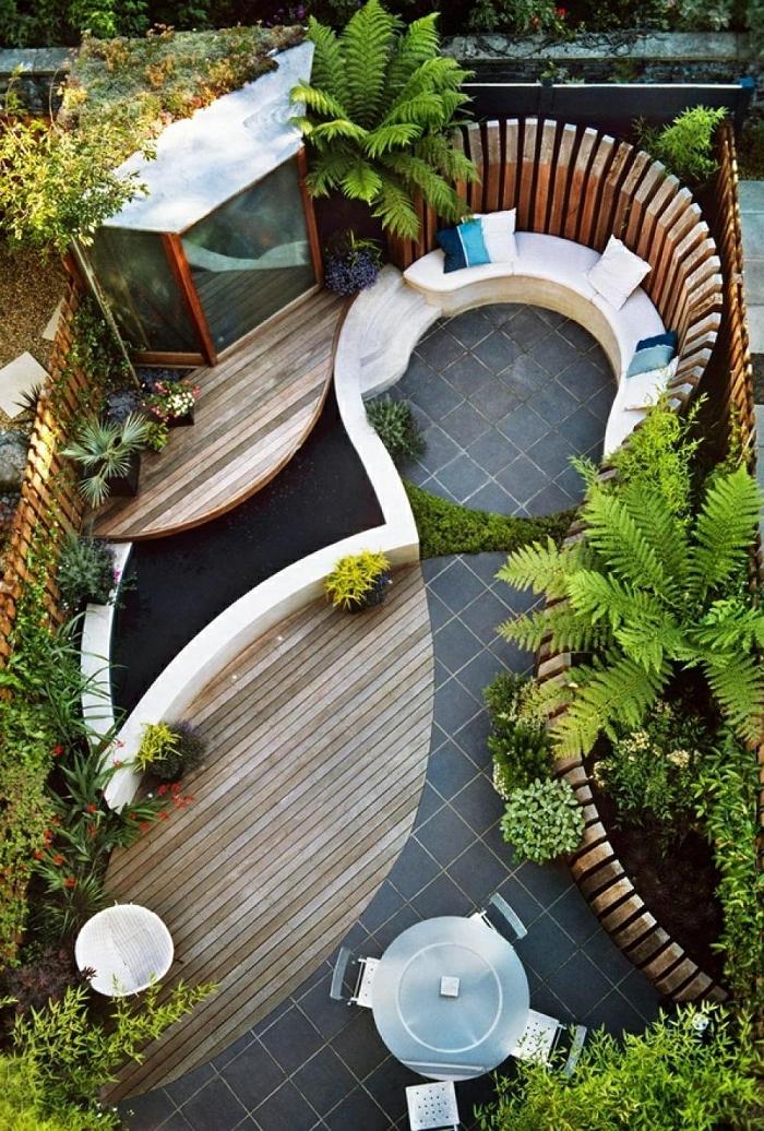 casas con jardin, propuesta super moderna para organizar tu patio moderno, líneas ovales, suelo nivelado, sitio para sentar con cojines decorativos