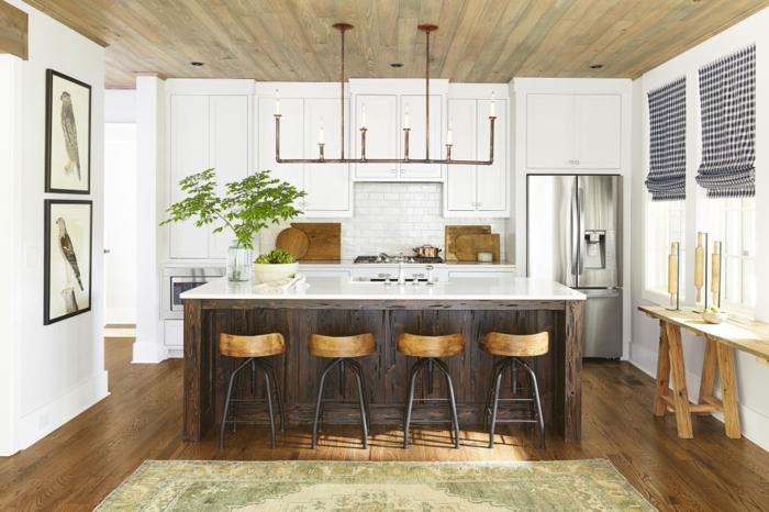 imagenes de cocinas modernas, ejemplo de estilo rústico, lámpara vanguardista, barra grande de madera con pequeña isla al lado, paredes decoradas