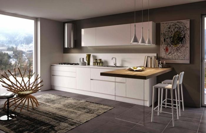 decoracion cocinas, cocina blanca con barra de amdera, suelo con baldosas y tapete, sillón y ventanal