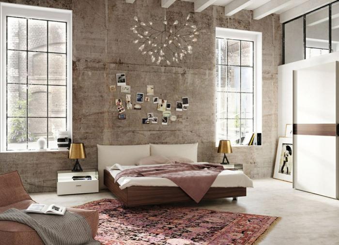 decorar habitacion, dormitorio matrimonio industrial, dos ventanas grandes, tapete rosado, lámpara de araña, cama doble y sillon