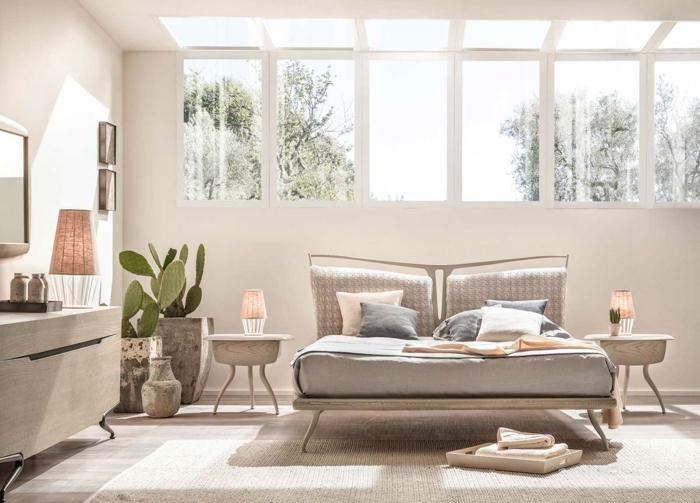 dormitorios matrimonio modernos, dormitorio con mucha luz, cama doble con cojines, cactuses y ventanas en el techo
