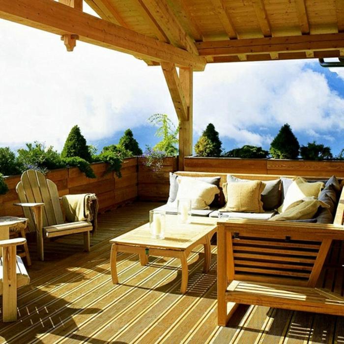 como hacer un jardin, ideas para convertir tu terraza en un jardín, glorieta de madera en color claro, cojines decorativos