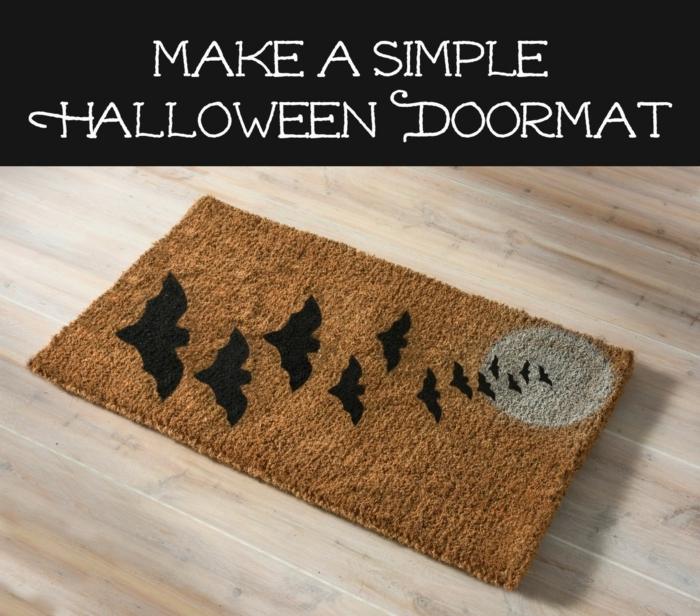 manualdiades de halloween, estera en beige decorada de murciélagos negros de diferente tamaño