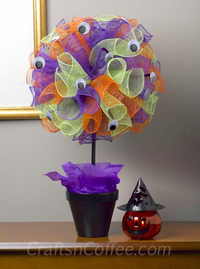 manualidades de halloween, decoración colorida y fácil, árbol en verde, lila y naranja, pequeña calabaza con vela dentro