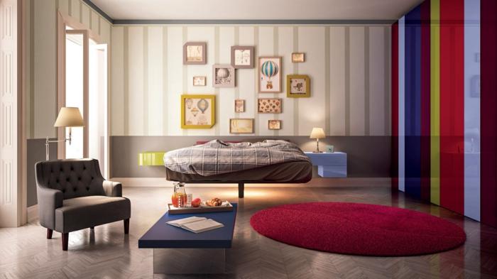 dormitorios de matrimonio, dormitorio con tapete rojo redondo, cama doble, sillón y muchos cuadros