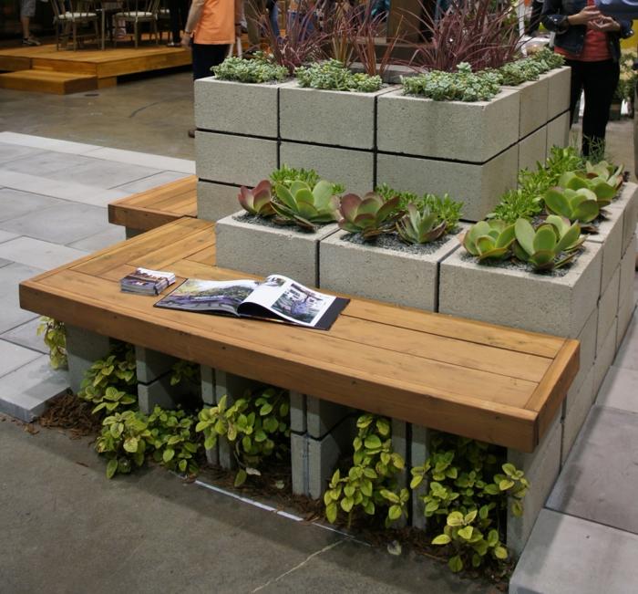 maceteros de madera, decoración de lugares públicos, banco de madera, maceteros de cemento con plantas verdes siemprevivas