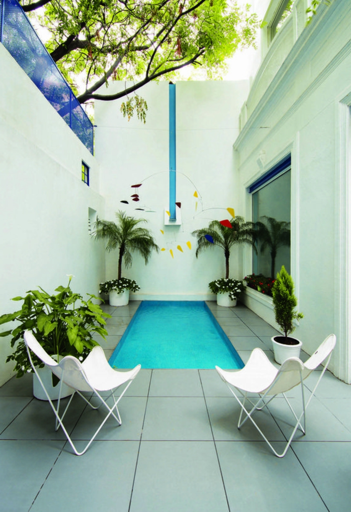 1001 ideas de piscinas peque as para tu patio for Disenos de casas con alberca y jardin