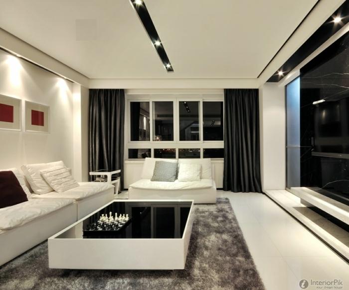 tipos de cortinas, salón muy moderno de estilo minimalista en blanco y negro, largas cortinas de satín en negro