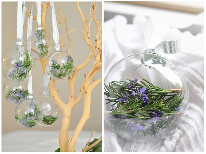 adornos de navidad caseros, esferas de cristal transparentes llenos de ramitos de rosmarino, adornos colgados en cintas blancas