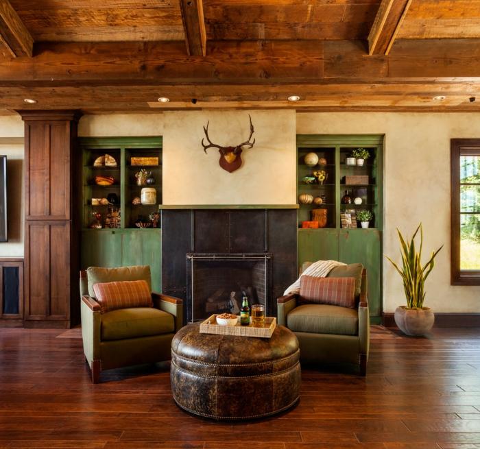 chimeneas de leña, propuesta acogedor, dos sillones vintage y mesa original en forma redonda, chimenea de acero