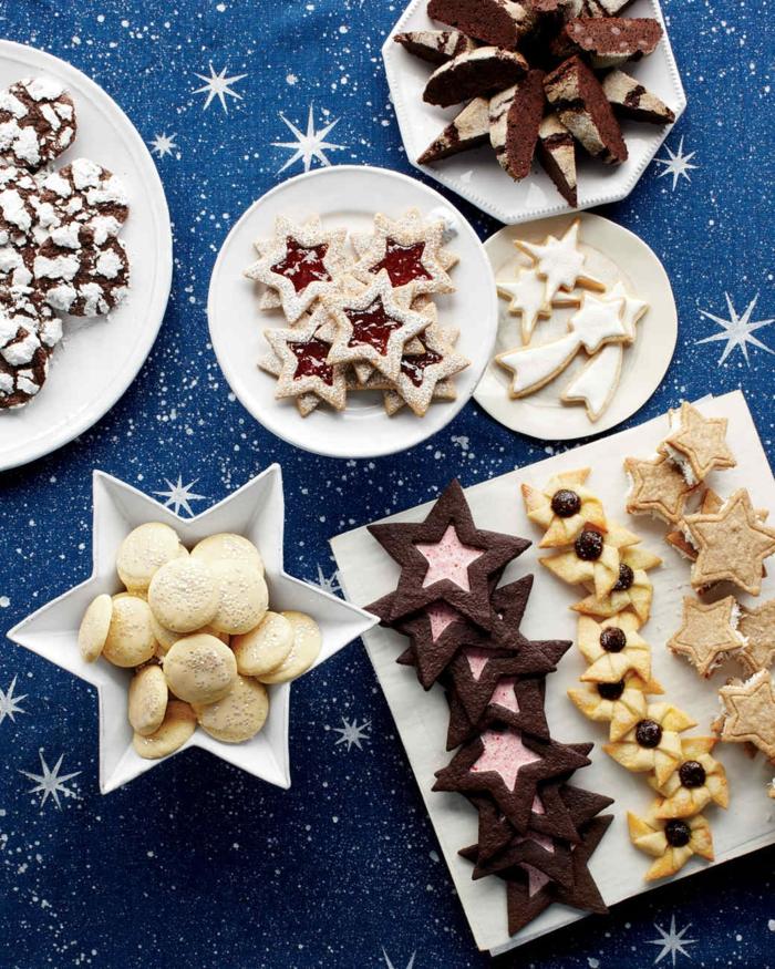 estrella de navidad, galletas y pasteles con motivos celestiales, cometas y estrellas dulces, manta con estrellas