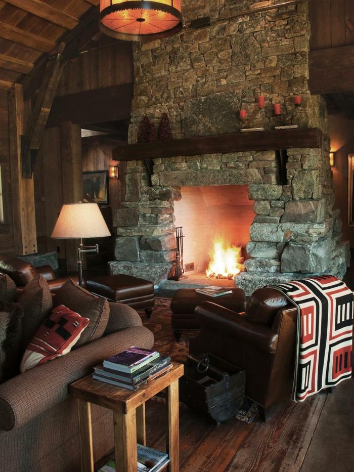 chimeneas de leña, idea en estilo rústico, grande chimenea de leña, sillones de piel en marrón, paredes de madera