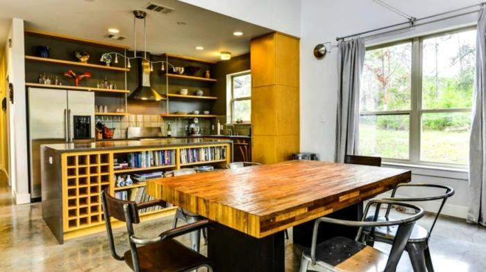 mesas de comedor moderno, mesa masiva de madera, cocina con comedor, barra con estantes original, lámparas empotradas en el techo