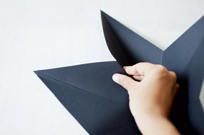 estrella de navidad, como doblar el cartón cortado en forma de estrella para conseguir un adorno tridimensional