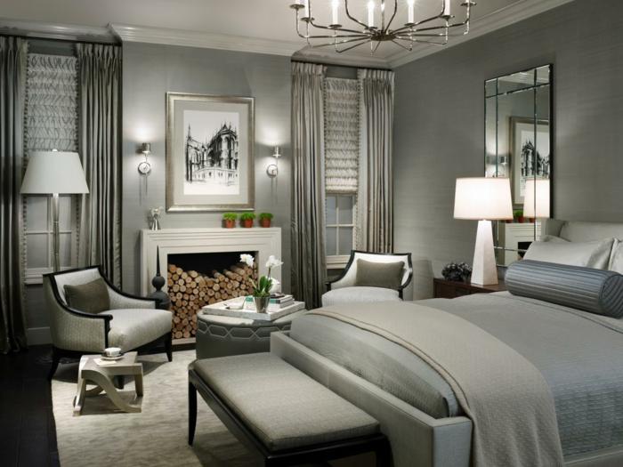 dormitorios modernos, ambiente en gris, muebles con toque vintage, candelabro clásico y pie de cama de madera