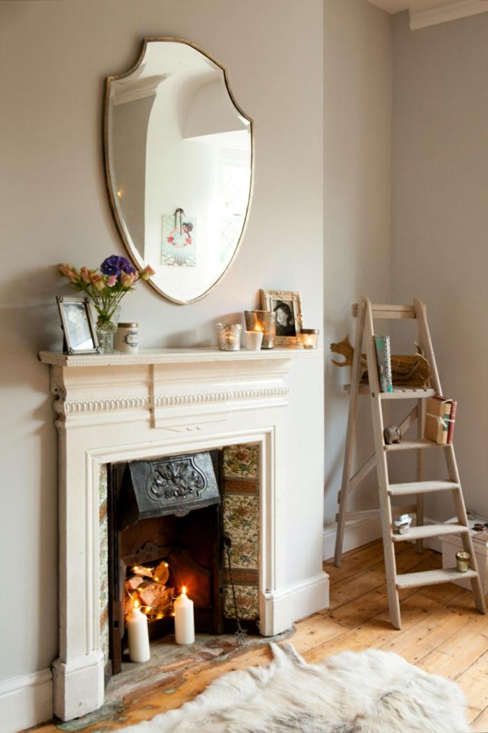 estufa de leña, bonito rincón en habitación luminosa en colores claros, espejo vintage y decoración en estilo provenzal
