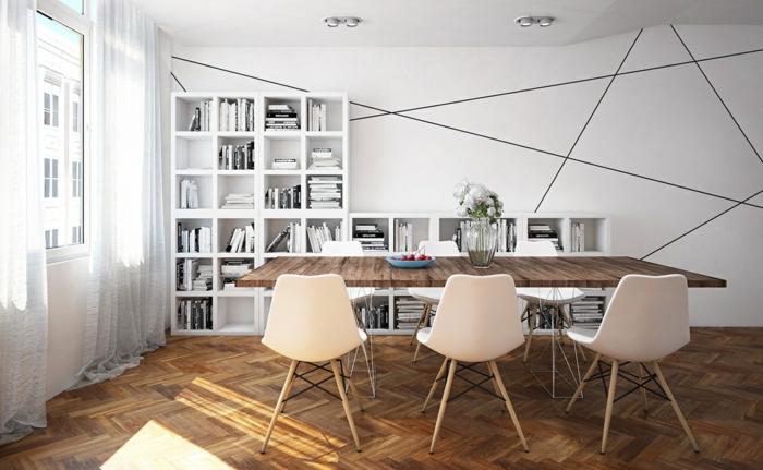 comedor moderno, bonito contraste entre el blanco y la madera, paredes con líneas, estantería blanca y mesa y suelo de madera