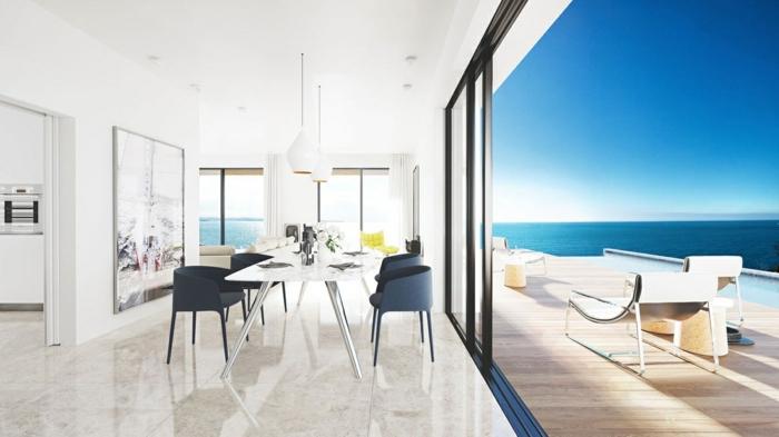 comedores modernos, bonito contraste entre el comedor blanco y las sillas en negro, preciosa vista al mar, suelo de mármol en beige
