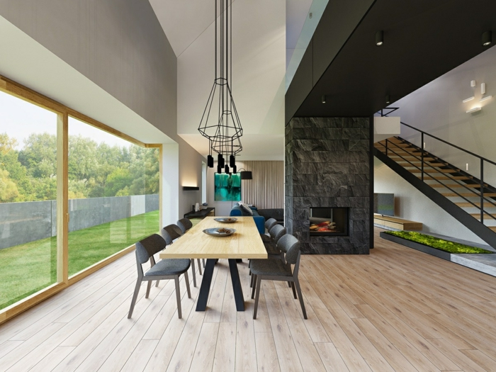 salon comedor, espacioso comedor en estilo minimalista, chimenea acogedora, mesa de madera y sillas en gris, grandes ventanales con vista al jardín
