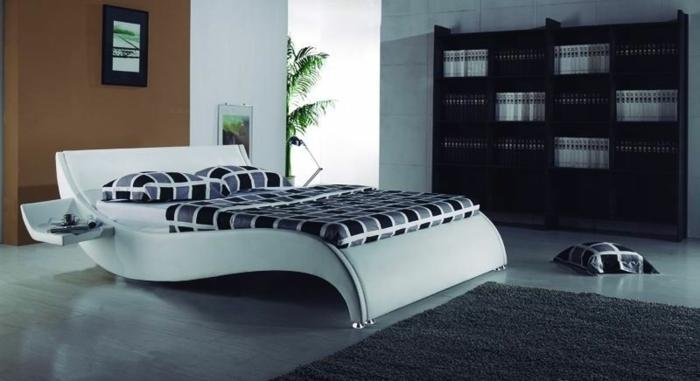 cabecero de madera, sama de diseño moderno, grande armario de madera, habitación en estilo minimalista