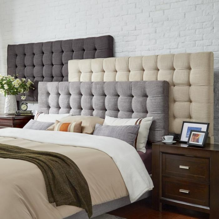 cabeceros originales, tres cabeceros de diferentes colores, cama matrimonio cómoda, paredes de ladrillos blancos