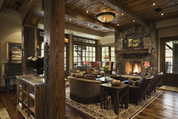 chimeneas rusticas, salón con comedor en estilo rústico, grande chimenea de piedra, vigas de madera masivas