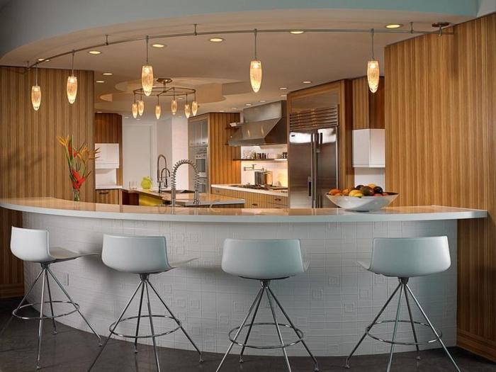 barra cocina, barra oval en gris, interesante propuesta para una casa moderna, lámparas colgantes en diseño original