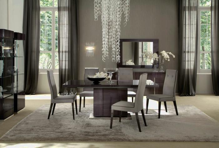 comedores moderrnos, comedor en gris con punto focal en la lámpara, alfombra de peluche, cortinas aireadas en gris