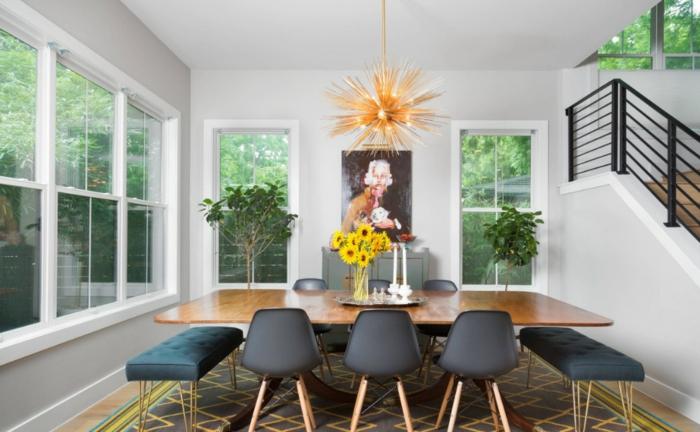 muebles comedor, propuesta acogedor y moderna, mesa grande de madera con sillas y bancos tapizados, decoración de plantas en macetas y girasoles