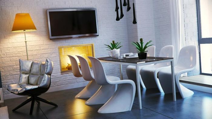 salon comedor, variante muy moderna, paredes con ladrillos blancos artificiales, sillas en blanco modernas, mesa rectangular, lámparas decorativas