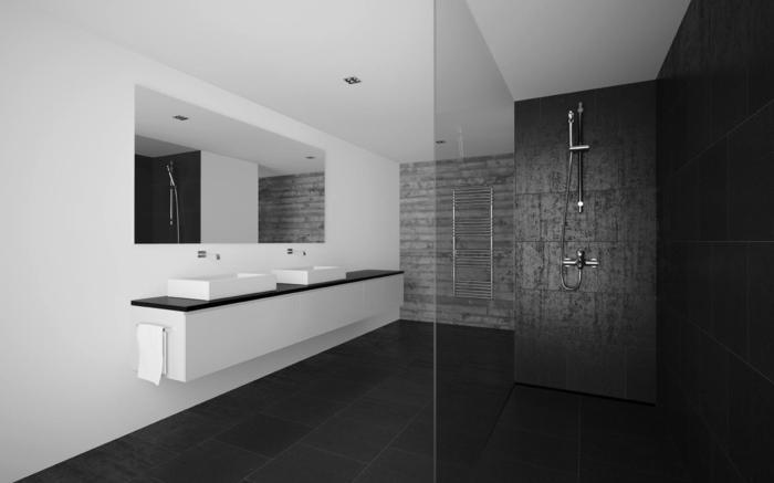 baños pequeños con ducha, baño en blanco y negro, espejo grande , lavabo doble, ducha de obra con pared de granito negro. mampara de vidrio