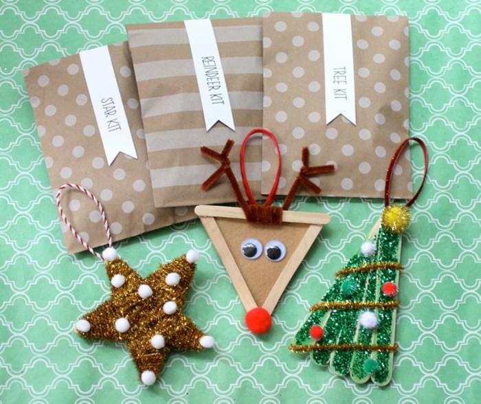 manualidades sencillas, decoración casera hecha de pequeños palos de madera, motivos de Navidad originales