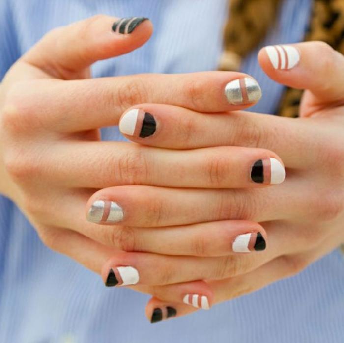 uñas de gel decoradas, uñas ovaladas de longitud media con partes pintadas en blanco, negro y esmalte transparente
