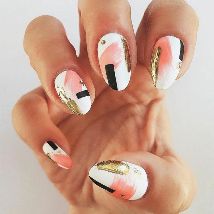 uñas de gel decoradas, uñas largas en forma almendra, pintadas en blanco con dibujos en negro, rosado y dorado