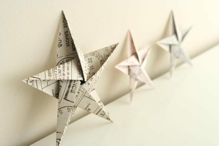 estrella navidad, tres estrellas de cinco puntos hechas de papel de periódico, manualidades faciles navideñas