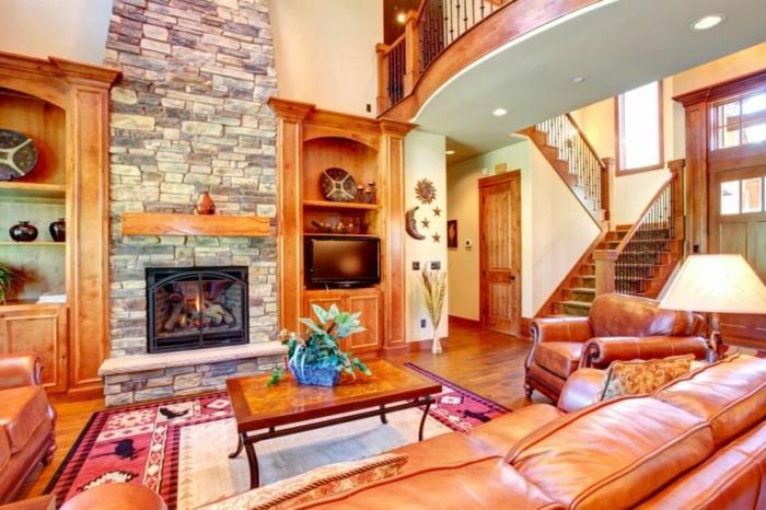 estufas de leña con horno, grande salón rústico, sofás y muebles de piel en color ocre, suelo de parquet