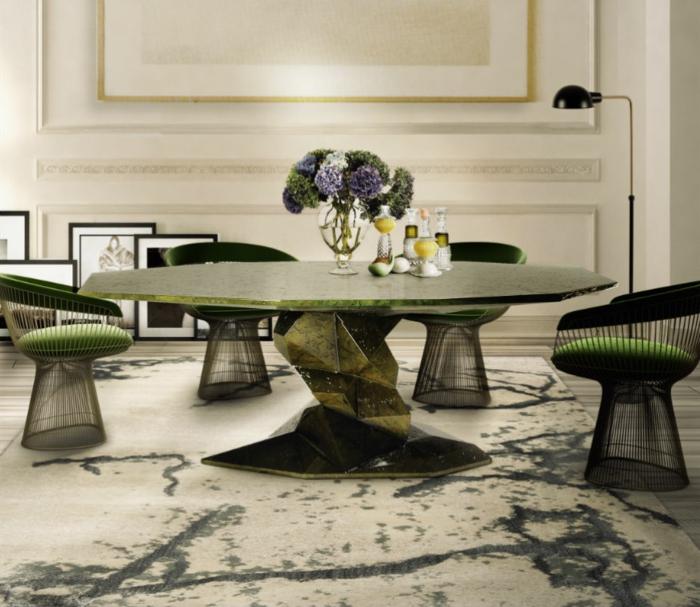 salon comedor, propuesta atrevida con una mesa verde y oval muy original, sillas moderna, alfombra en blanco y gris y decoración de flores