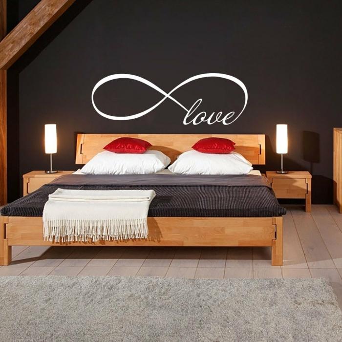 decoracion paredes, vinilo decorativo para dormitorio de pareja, vinilo blanco signo del infinito, pared oscura, cama doble