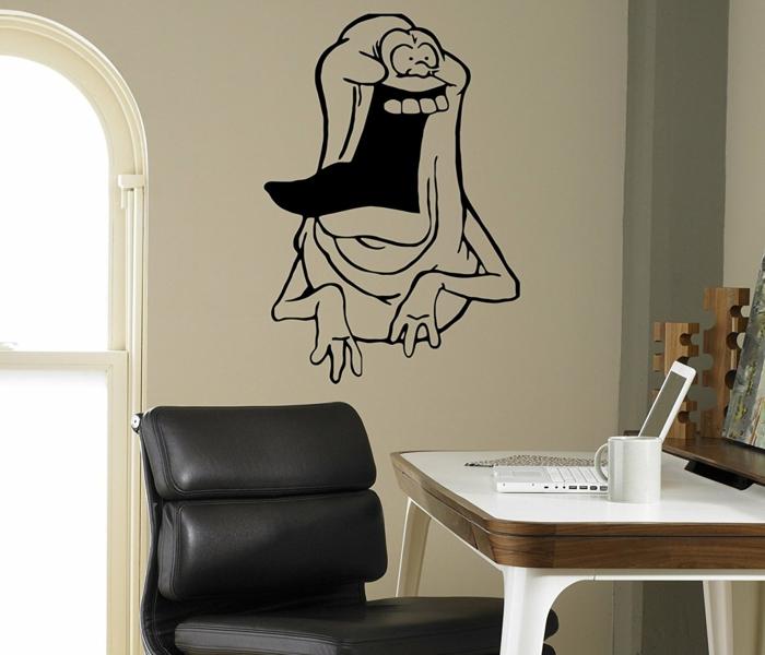 vinilos infantiles, habitación con escritorio, vinilo negro con monstruo divertido sobre pared blanca