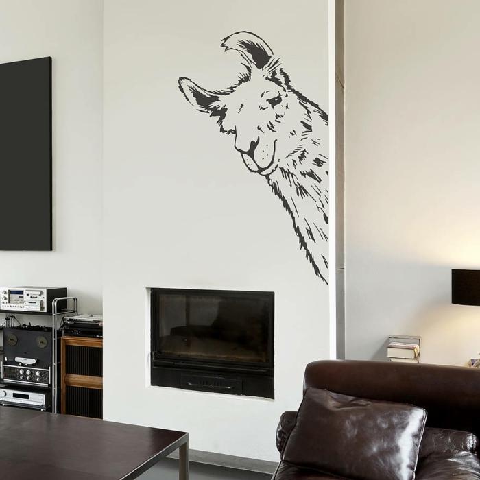 decoracion paredes, sala de estar con paredes blancas y chimenea, vinilo decorativo divertdio con cabeza de llama