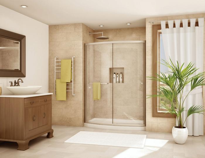 ducha de obra, baño con paredes y suelo de baldosas, lavabo clásico, mueble de madera, ventana grande, ducha de obra con plato y nicho en la pared